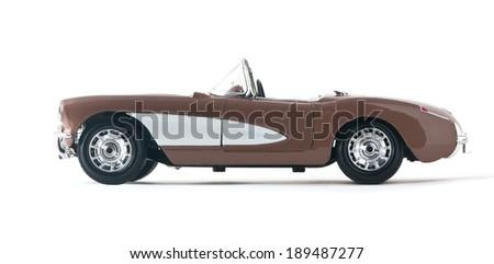 Almaty, Kazakhstan - March 6, 2014: Collectible toy car convertible Chevrolet Corvette 1957 on a white background - stock photo