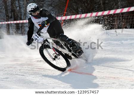 ALMATY, KAZAKHSTAN - MARCH 3: Competitor E.Ushakova (N41) in action at Beeline Snow BikeCross in Almaty, Kazakstan, March 3, 2012. - stock photo