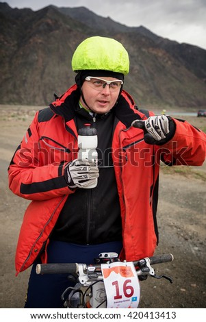 "ALMATY, KAZAKHSTAN - MAY 02, 2016: A.Batalov (N16) on start at Adventure mountain bike cross-country competition in mountains ""Jeyran Trophy 2016""  - stock photo"