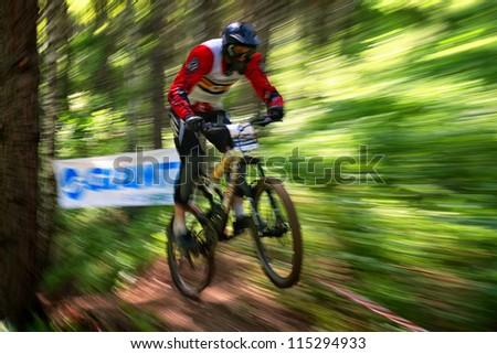 ALMATY, KAZAKHSTAN - MAY 27: A.Ryazanov (N6) in action at Freestyle Mountain Bike Session in Almaty, Kazakhstan MAY 27, 2012. - stock photo