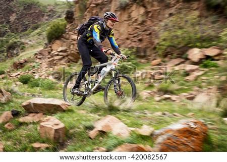 "ALMATY, KAZAKHSTAN - MAY 01, 2016: D.Rahimkulov (N2) in action at Adventure mountain bike cross-country competition in mountains ""Jeyran Trophy 2016""  - stock photo"