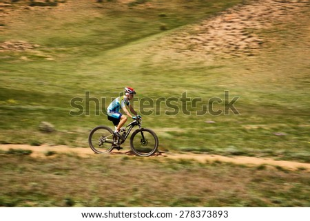 "ALMATY, KAZAKHSTAN - MAY 1, 2015: G.Torgautov (N14) in action at Adventure mountain bike marathon ""Jeyran Trophy 2015"" - stock photo"