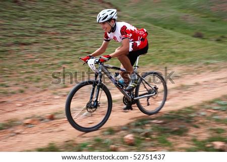 "ALMATY, KAZAKHSTAN - MAY 1: R.Fayzullin (N17) in action at Adventure mountain bike cross-country marathon in mountains ""Jeyran Trophy 2010"" May 1, 2010 in Almaty, Kazakhstan. - stock photo"