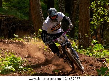 ALMATY, KAZAKHSTAN - MAY 27: V.Serjantov (N4) in action at Freestyle Mountain Bike Session in Almaty, Kazakhstan MAY 27, 2012. - stock photo