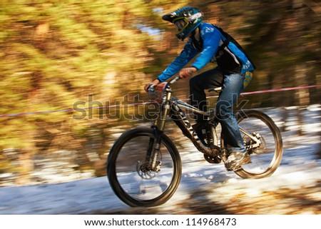 ALMATY, KAZAKHSTAN - NOVEMBER 06: A.Zubenko(N30) in action at downhill mountain bike 'Pumpkin Race Mini DH. Halloween' November 06, 2011 in Almaty , Kazakhstan. - stock photo