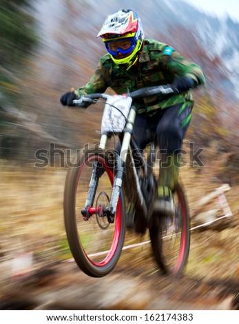 "ALMATY, KAZAKHSTAN - NOVEMBER 3: R.Sadiev (N13) in action at  mountain bike sports event ""Pumpkin Race 2013"" November  3, 2013 in Almaty, Kazakhstan. - stock photo"