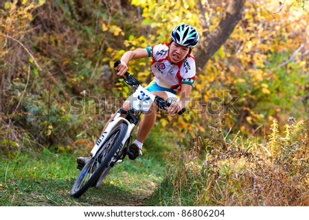 ALMATY, KAZAKHSTAN - OCTOBER 16: S.Mamutov(N32) in action at cross-country mountain bike 'Apple race' October 16, 2011 in Almaty , Kazakhstan. - stock photo