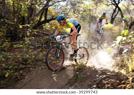 ALMATY, KAZAKHSTAN - OCTOBER 18: Vadim Galeev in action at cross-country mountain bike 'Apple race' October 18, 2009 in Almaty , Kazakhstan. - stock photo