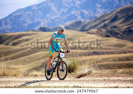 "ALMATY, KAZAKHSTAN - SEP 13, 2009: Alexey Kozyrev (N1) in action at Adventure mountain bike cross-country competition in mountains ""Bartogay marathon 2009""  - stock photo"