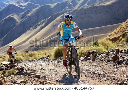 "ALMATY, KAZAKHSTAN - SEP 06, 2015: I.Makhmutov (N6) - athlete with physical disabilities in action at Adventure mountain bike cross-country competition in mountains ""Bartogay Marathon 2015""  - stock photo"