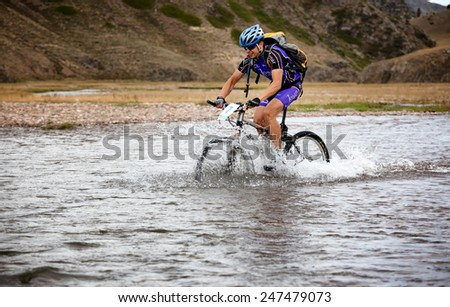 "ALMATY, KAZAKHSTAN - SEP 09, 2009: I.Popov (N7) in action at Adventure mountain bike cross-country competition in mountains ""Bartogay marathon 2009""  - stock photo"
