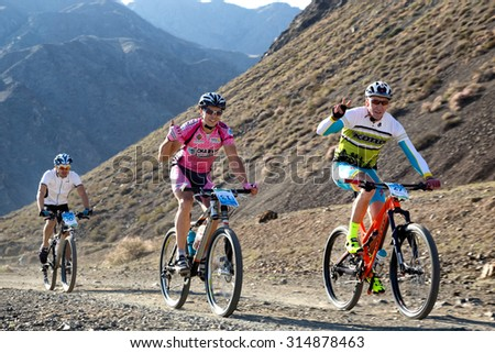 "ALMATY, KAZAKHSTAN - SEP 06, 2015: M.Sotnikov (N27) and others in action at Adventure mountain bike cross-country competition in mountains ""Bartogay Marathon 2015""  - stock photo"