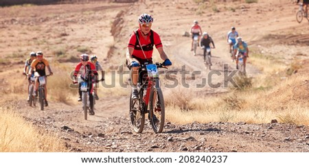 "ALMATY, KAZAKHSTAN - SEPTEMBER 09: A.Kulkin (N34) and other in action at Adventure mountain bike cross-country marathon ""Marathon Bartogay-Assy-Batan 2012"" on September 09, 2012 in Almaty, Kazakhstan. - stock photo"