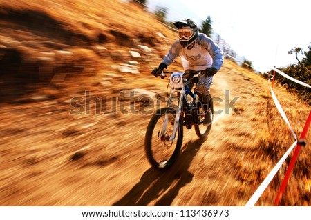 "ALMATY, KAZAKHSTAN - SEPTEMBER 16: A.Sadvokasov (N17)  in action at ""Open Championship in Almaty - DOWNHILL"" in Almaty, Kazakhstan, September 16, 2012. - stock photo"