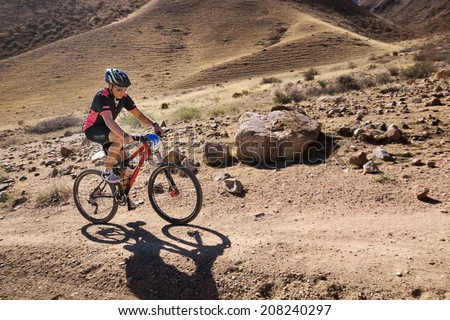 "ALMATY, KAZAKHSTAN - SEPTEMBER 09: R.Jukov (N17) and other in action at Adventure mountain bike cross-country marathon ""Marathon Bartogay-Assy-Batan 2012"" on September 09, 2012 in Almaty, Kazakhstan. - stock photo"