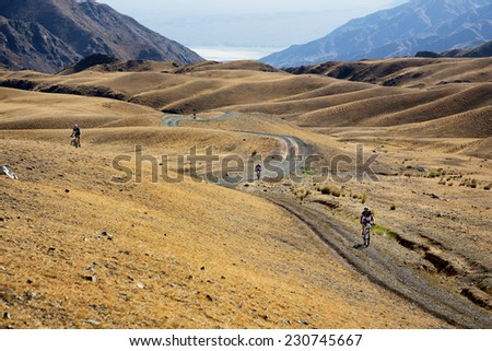 "ALMATY, KAZAKHSTAN - SEPTEMBER 09, 2014: Unknown bikers  in action at Adventure mountain bike cross-country marathon ""Marathon Bartogay-Assy-Batan ""  - stock photo"