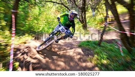 "ALMATY, KAZAKSTAN - AUGUST 03: D.Gafurov (N10) in action at Mountain Bike sports event Superiority of ""Cycling club named A.Vinokurov"" Downhill in Almaty, Kazakstan Aug 03, 2013.  - stock photo"