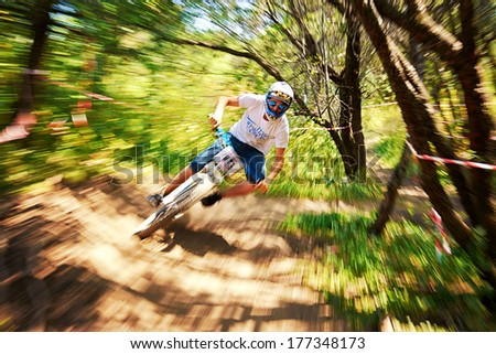 """ALMATY, KAZAKSTAN - AUGUST 03: D.Masalsky (N15) in action at Mountain Bike sports event Superiority of """"Cycling club named A.Vinokurov"""" Downhill in Almaty, Kazakstan Aug 03, 2013.  - stock photo"""