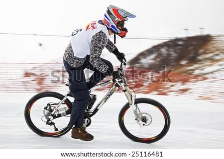 Almaty, Kazakstan - February 15: Red Bull Snow BikeCross, February 15, 2009 in Almaty, Kazakstan. Competitor Farit Saushkin N15 - stock photo