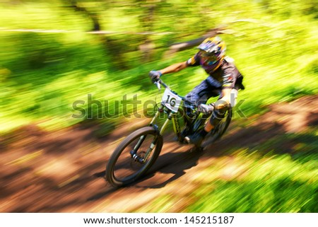ALMATY, KAZAKSTAN - JUNE 30: S.Zakirov (N16) in action at  Mountain Bike sports event dedicated to the Day of the capital in Almaty, Kazakstan JUNE 30, 2013. - stock photo