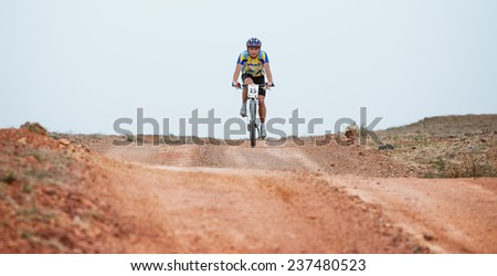"ALMATY, KAZAKSTAN - MAY 01, 2009: N.Jandubaev (N15) in action at Adventure mountain bike cross-country marathon in mountains ""Jeyran Trophy 2009""  - stock photo"