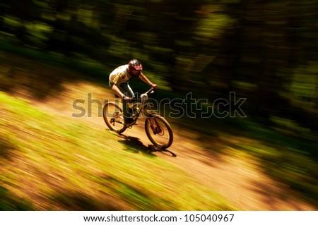 ALMATY, KAZAKSTAN - MAY 27: R.Alabujev (N55) in action at Freestyle Mountain Bike Session in Almaty, Kazakstan MAY 27, 2012. - stock photo