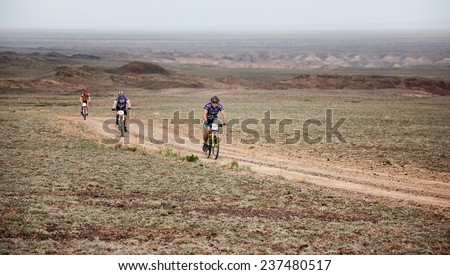"ALMATY, KAZAKSTAN - MAY 01, 2009: R.Nurjanov (N10) in action at Adventure mountain bike cross-country marathon in mountains ""Jeyran Trophy 2009""  - stock photo"