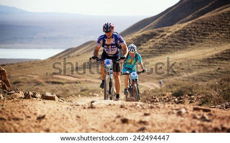 "ALMATY, KAZAKSTAN - SEP 09, 2009: I.Baranov (N6) in action at Adventure mountain bike cross-country competition in mountains ""Bartogay marathon 2009""  - stock photo"