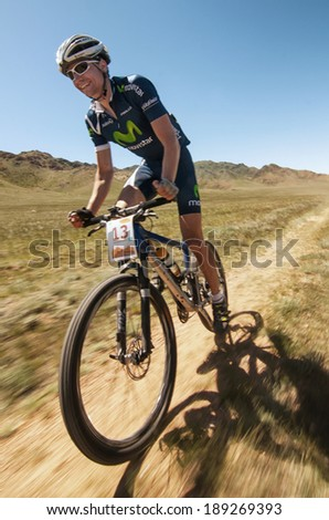 "ALMATY REGION, KAZAKHSTAN - MAY 5, 2013: A.Buyanauskas (N13) in action at Adventure mountain bike cross-country marathon in mountains ""Jeyran Trophy 2013"".  - stock photo"