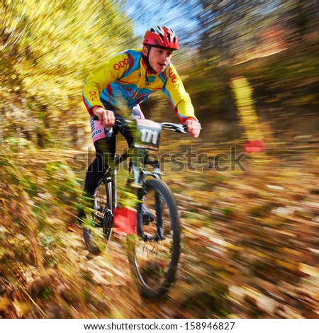 "ALMATY REGION, KAZAKHSTAN - OCTOBER 13: K.Grabovsky (N171) in action at  mountain bike sports event ""Red Bull Mountain Rage"" October 13, 2013 in Almaty region, Kazakhstan. - stock photo"