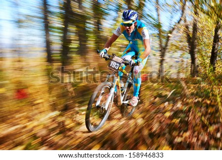 "ALMATY REGION, KAZAKHSTAN - OCTOBER 13: Y.Shkedin (N193) in action at  mountain bike sports event ""Red Bull Mountain Rage"" October 13, 2013 in Almaty region, Kazakhstan. - stock photo"