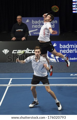 ALMERE - FEBRUARY 2: Jacco Arends (front) and Jelle Maas (back) win the gold medal in the National Championships badminton 2014 in Almere, The Netherlands on February 2, 2014. - stock photo