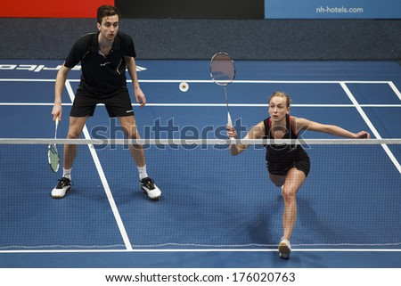 ALMERE - FEBRUARY 2: Jacco Arends (left) and Selena Piek (right) reach the final in the National Championships badminton 2014 in Almere, The Netherlands on February 2, 2014. - stock photo