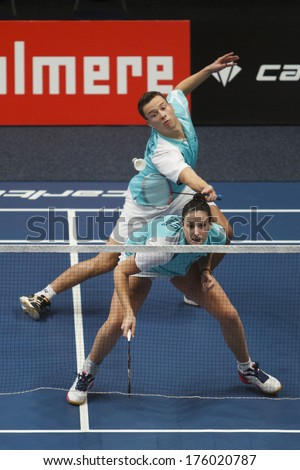 ALMERE - FEBRUARY 1: Samantha Barning (front) and Jorrit de Ruiter (back) reach the semi finals in the National Championships badminton 2014 in Almere, The Netherlands on February 1, 2014. - stock photo