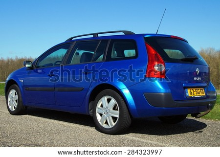 Almere, Flevoland, The Netherlands - March 17, 2015: Metallic Blue Renault Megane Grand Tour II 1.6 16V Tech Line. This model 2005 is the second generation of the popular French family car - stock photo