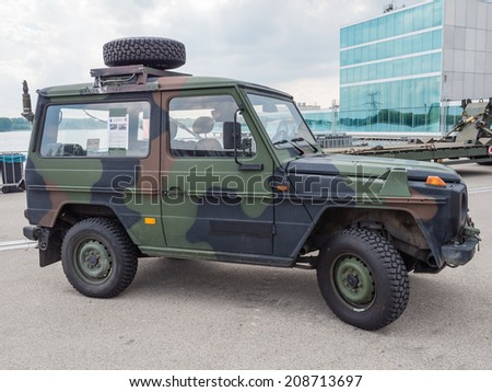 ALMERE, NETHERLANDS - 23 APRIL 2014: Dutch military all-terrain vehicle on display during the National Army Day in Almere can be inspected by the general public at close range - stock photo