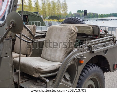 ALMERE, NETHERLANDS - 23 APRIL 2014: Dutch military vintage jeep that served in WW II on display during the National Army Day in Almere can be inspected by the general public at close range - stock photo