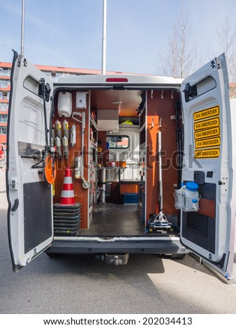 ALMERE, NETHERLANDS - 12 APRIL 2014: Look inside a van of the Dutch forensic investigation service on display during the first National Security Day held in the city of Almere - stock photo