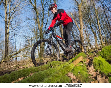ALMERE, NETHERLANDS - FEB. 3, 2014: Mountain biker test riding a brand new  state of the art electric powered mountainbike which uses a motor and provides a smooth and easy ride on rough terrain - stock photo