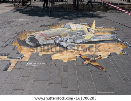 ALMERE, NETHERLANDS - JUNE 30: Street art showing the power of 3D optical illusion during the annual Street Art Festival held in the streets of the city of Almere on June 30, 2013 - stock photo
