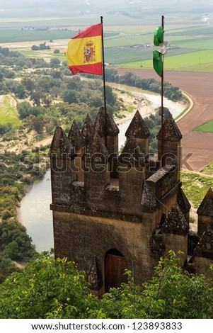 Almodovar Del Rio medieval castle with flags of Spain and Andalusia - stock photo