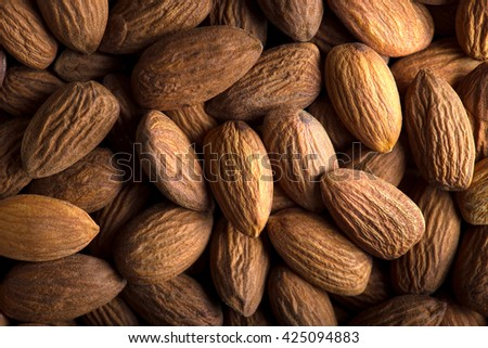 Almond. Almond background. Group of almonds. Peeled almonds. Pile of almonds. Almonds kernel. - stock photo