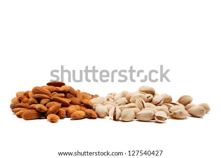 Almond and pistachio nuts isolated on white background. - stock photo