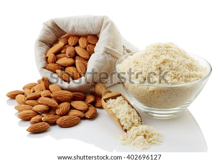 Almond flour and almonds isolated on white background - stock photo