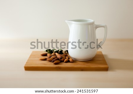 almond milk and wooden board - stock photo