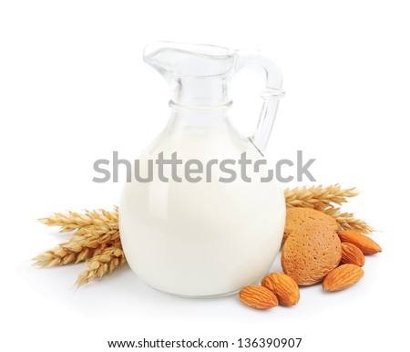 Almond milk with almonds isolated on white - stock photo