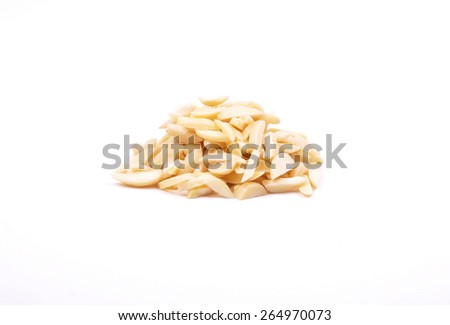 Almond slivers on white - stock photo