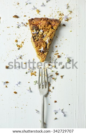 almond tarte with flowers - stock photo