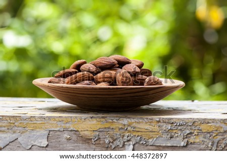 Almonds. Almonds on wooden table. Almonds background. Group of almonds. Peeled almonds. Pile of almonds. Almonds kernel. Almonds nuts. - stock photo