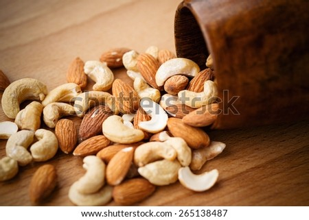 Almonds And Cashew Nuts On A Wooden Background - stock photo